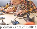 Attentive young technician in light studio 28290814