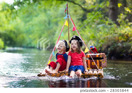 Kids playing pirate adventure on wooden raft 28303844