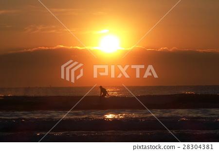 Sunrise and surfer 28304381