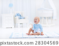 Baby boy with bottle drinking milk or formula 28304569