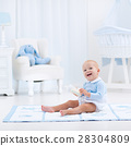 Baby boy with bottle drinking milk or formula 28304809
