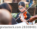 Young asian female violinist performing in concert 28308481