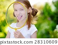 Cute little girl playing badminton outdoors 28310609