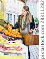 Pregnant woman shopping groceries on market 28311282