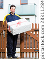 Postman delivering packet wrapped as present 28311284