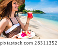 woman at tropical beach eating fruit for breakfast 28311352