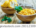 Canned corn in a wooden bowl. 28312309