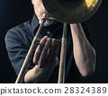 Playing trombone, close up shot 28324389