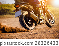 man  riding touring enduro motorcycle on dirt 28326433