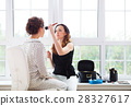 Make-up artist doing make up for young bride 28327617