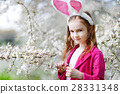 Adorable little girl in blooming cherry garden 28331348