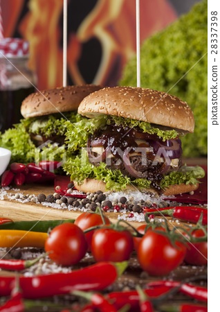 Close-up of home made burgers, wooden  28337398
