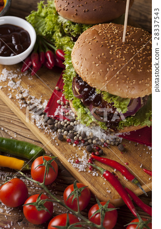 Home made burgers on wooden background 28337543