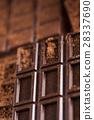 Dark homemade chocolate bars and cocoa pod  28337690