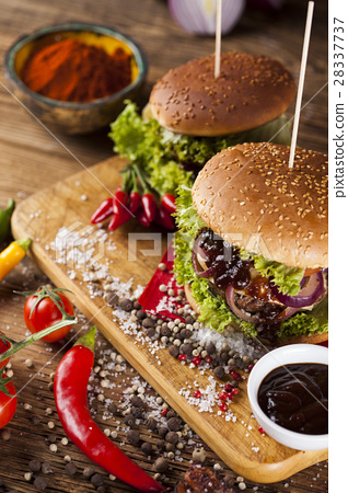 Home made burgers on wooden background 28337737