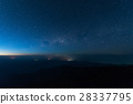 Stars illuminated above the dark mountain. 28337795