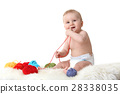 Cute little baby playing with balls of wool  28338035