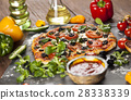 Tasty pizza, tomatoes and others ingredients  28338339