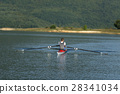 Child in the course of rowing on single 28341034