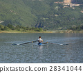 Child in the course of rowing on single 28341044
