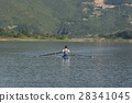 Child in the course of rowing on single 28341045