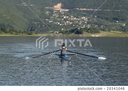 Child in the course of rowing on single 28341046