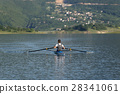 Child in the course of rowing on single 28341061
