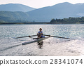 Child in the course of rowing on single 28341074