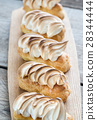 Eclairs with lemon curd and meringue 28344444