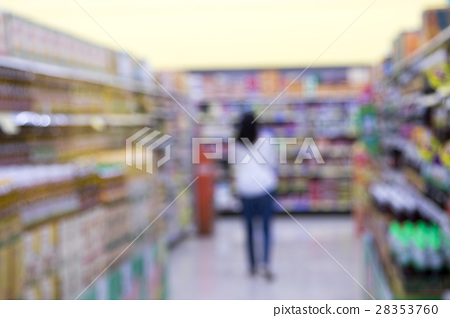 Blurred image of a woman with a shopping. 28353760