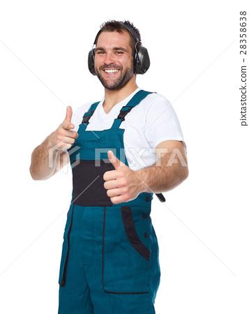 Worker in green uniform with protective earphones 28358638