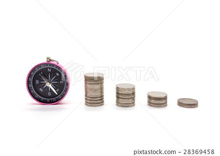 compass and coins on white background 28369458