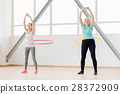 Positive active women rotating hula hoops 28372909