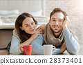Smiling young couple expressing love at home 28373401