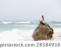 Girl sit at the seaside on the rock and meditating 28384916