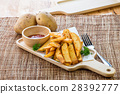 Tasty french fries on cutting board with ketchup 28392777