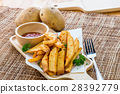 Tasty french fries on cutting board with ketchup 28392779