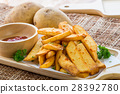 Tasty french fries on cutting board with ketchup 28392780