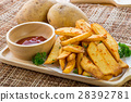 Tasty french fries on cutting board with ketchup 28392781