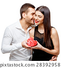 Young beautiful couple with present isolated on 28392958