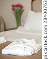 white bathrobe on the bed 28400763