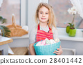 Little blonde girl holding basket with painted 28401442