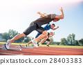 Runners preparing for race at starting blocks 28403383