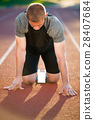 Athletic man on track starting to run. Healthy 28407684