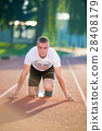 Athletic man on track starting to run. Healthy 28408179
