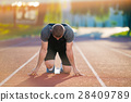 Athletic man on track starting to run. Healthy 28409789