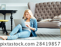 Hardworking woman using laptop at home 28419857