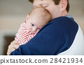 Happy proud young father with newborn baby 28421934