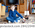 Little blond preschool kid boy playing with toy 28422048