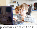 Two kids boys playing online chess board game on 28422313